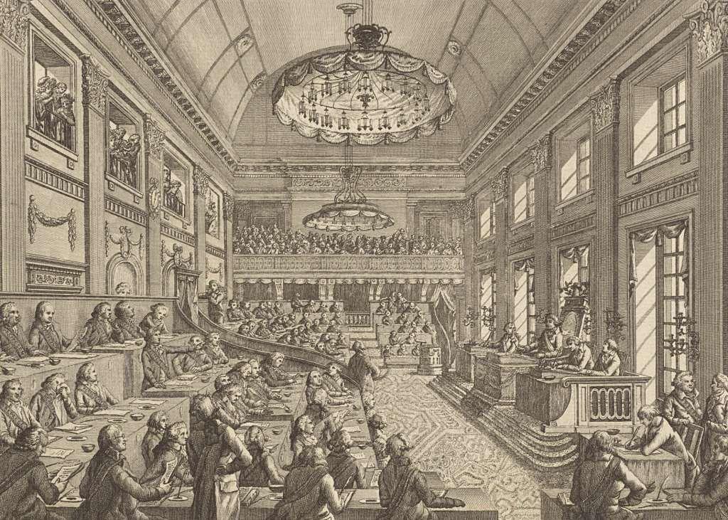 De Eerste Nationale Vergadering in Den Haag. Rechts op de verhoging zit voorzitter Pieter Paulus. De vergadering werd gehouden in het gebouw van de latere Tweede Kamer (de oude zaal met de groene bankjes). Gravure, Reinier Vinkeles, 1796. (Rijksmuseum)