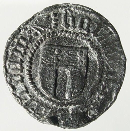 Helft van een lakenlood, verwijzend naar de lakenhandel in Westenschouwen. Datering 1400-1500. (Gemeentelijke Musea Zierikzee)