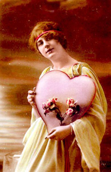 Rozen en een hart: twee symbolen voor de liefde en Valentijnsdag. (Amerikaanse Valentijnskaart, omstreeks 1910)
