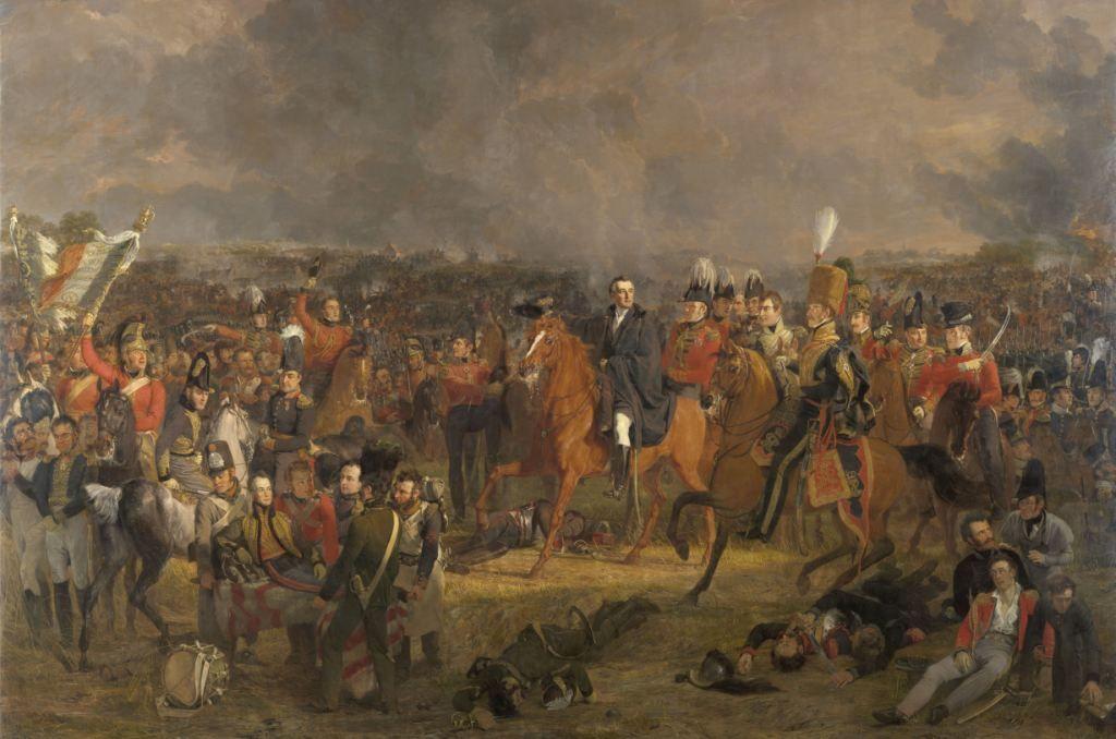 De Slag bij Waterloo, schilderij door Jan Willem Pieneman, 1824. Op de voorgrond links ligt de gewonde prins Willem op een draagbaar. In het midden te paard de hertog van Wellington, bevelhebber van de Brits-Nederlandse troepen. (Collectie Rijksmuseum)
