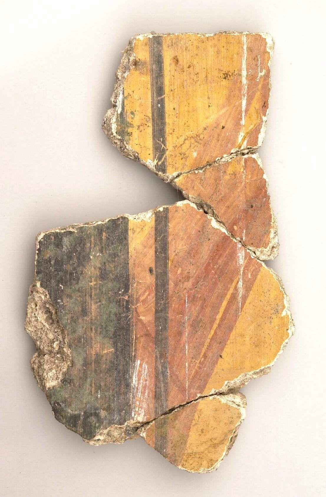 Romeinse muurschildering uit Aardenburg, met imitaties van groen porfier en geel-rood giallo antico-marmer (beeldbank SCEZ).